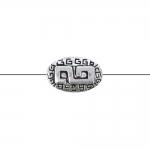 Ovaalne, lapik, reljeefse mustriga, pikuti läbistatud metallhelmes, 15x8x5mm