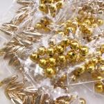 Kuldsed plastpärlid