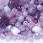 Pärlisegu lillakatest erikujulistest pärlitest 6-20mm, 100/50g pakk