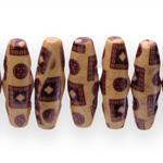 Piklikud pöörad/puithelmed  aafrikapäraste mustritega kahe nööbilaadselt asetseva auguga 30x10mm