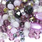 Pärlisegu lillakatest erikujulistest pärlitest 6-18mm, 100/50g pakk